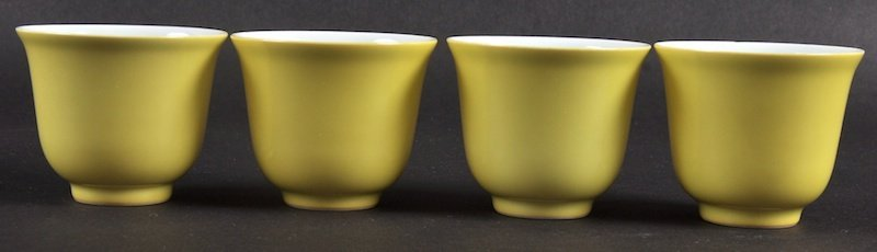 A SET OF FOUR CHINESE YELLOW GROUND PORCELAIN TEABOWLS