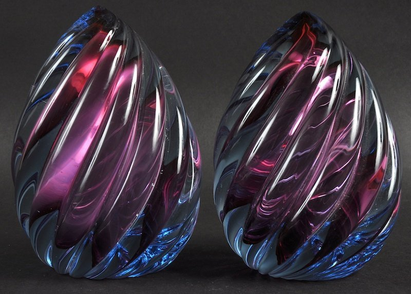 A PAIR OF HEAVY PAPERWEIGHTS. £40-50.