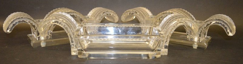 A LALIQUE FROSTED TABLE SET decorated with acanthus