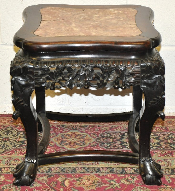 A 19TH CENTURY CHINESE CARVED HARDWOOD STAND of square
