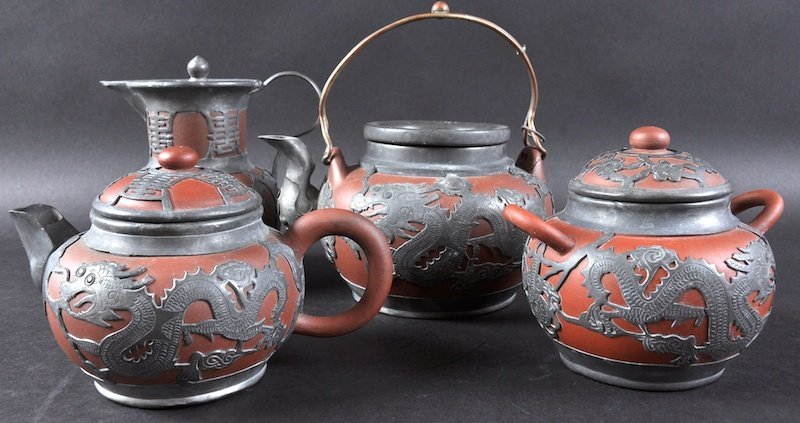 AN EARLY 20TH CENTURY CHINESE PEWTER AND POTTERY FOUR