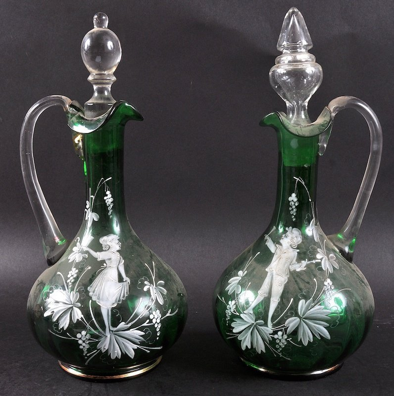 A PAIR OF VICTORIAN GREEN TINTED MARY GREGORY CLARET