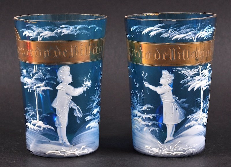 A PAIR OF VICTORIAN BLUE MARY GREGORY GLASS CUPS