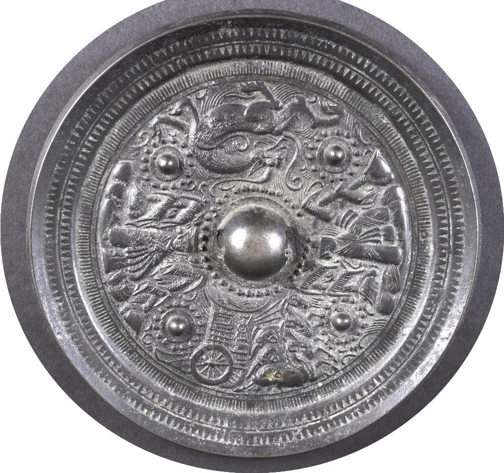 A FINE LARGE CHINESE CIRCULAR BRONZE HAND MIRROR