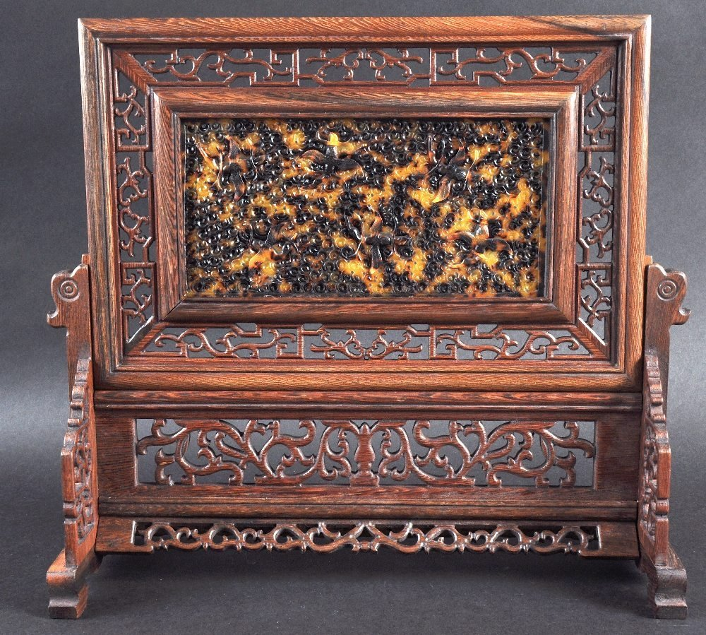 AN EARLY 20TH CENTURY CHINESE CARVED HARDWOOD TABLE