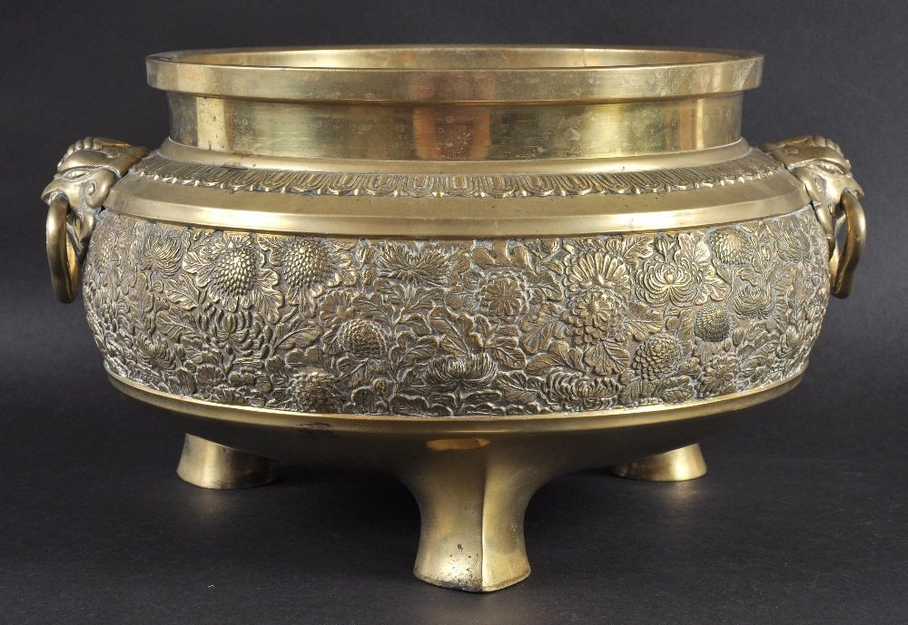 A 19TH CENTURY EASTERN ENGRAVED BRASS CENSER with twin