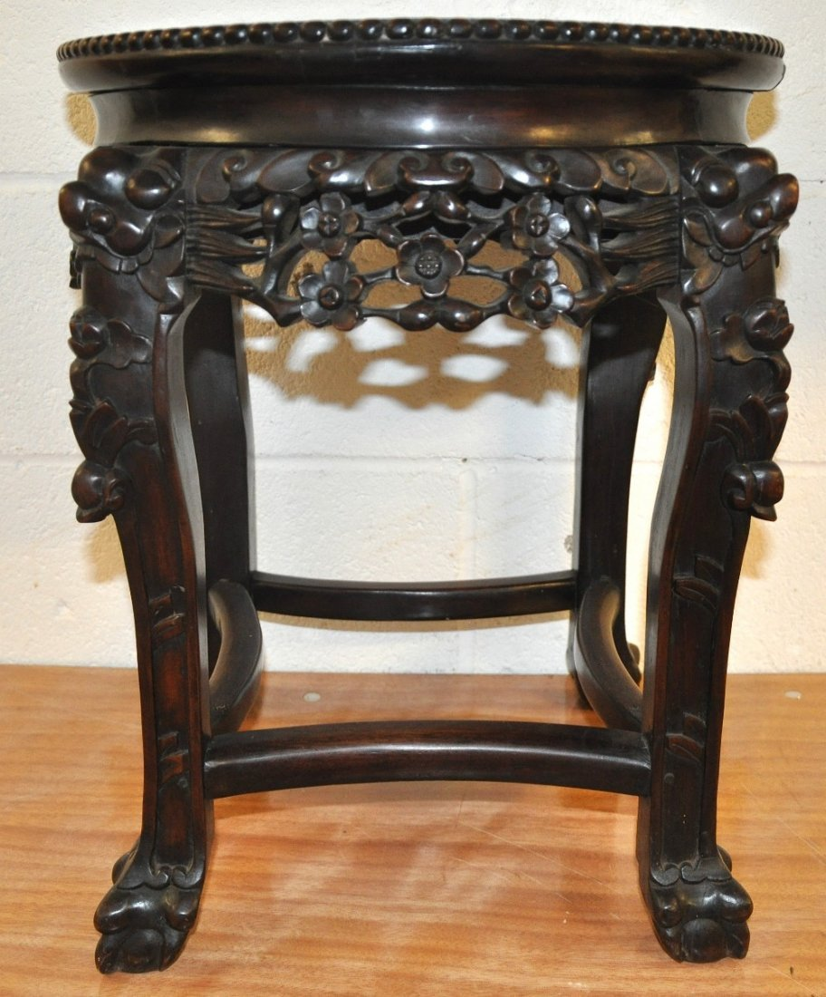 A 19TH CENTURY CHINESE CARVED HARDWOOD MARBLE STAND
