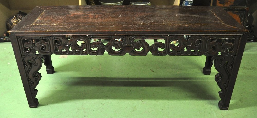 AN EARLY 20TH CENTURY CHINESE CARVED SOFTWOOD TABLE