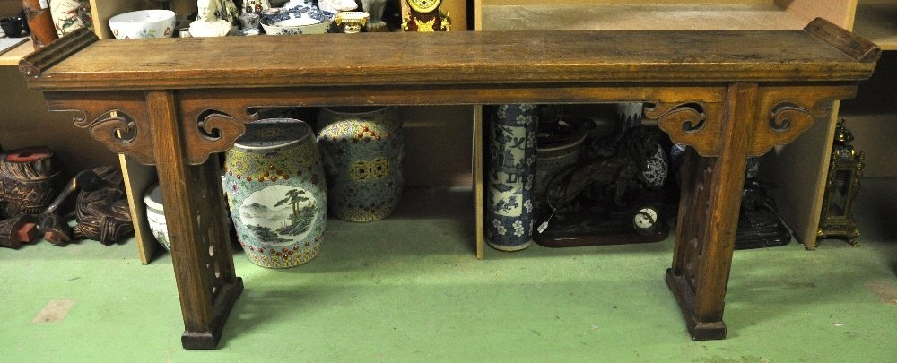 A 19TH CENTURY CHINESE PROVINCIAL CARVED HARDWOOD TABLE
