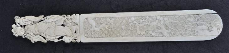A 19TH CENTURY CHINESE CARVED CANTON IVORY PAPER KNIFE