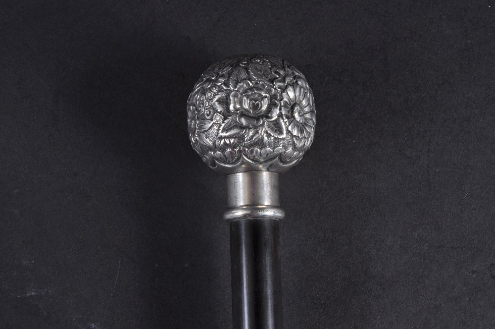 A SILVER TOPPED STICK by TIFFANY USA.  Date: 1890.