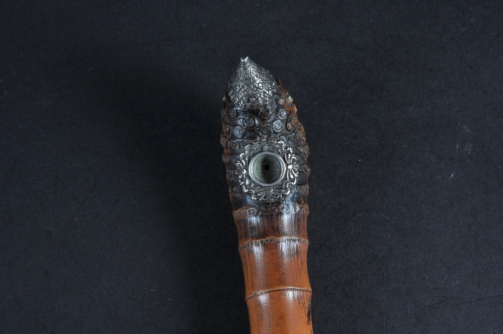 A SILVER AND WHITE METAL SNAKE OPIUM PIPE.  Date: 1870.