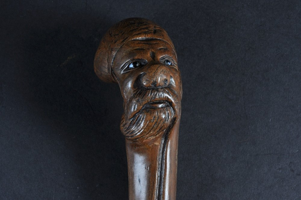 A CARVED WOOD RUSSIAN MAN. Date: 1870.  Country: