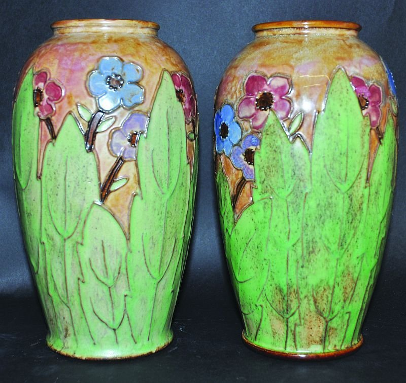 A PAIR OF ROYAL DOULTON STONEWARE VASES, tube lined