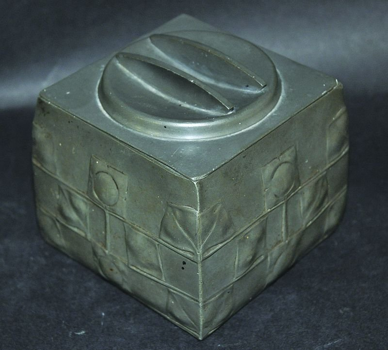 A LIBERTY & CO TUDRIC PEWTER TEA CADDY AND COVER, of