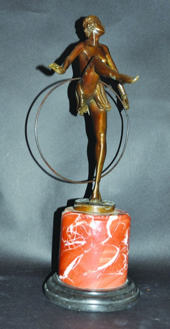 AFTER D. ALONZO. A BRONZE GIRL DANCER WITH A HOOP, on a