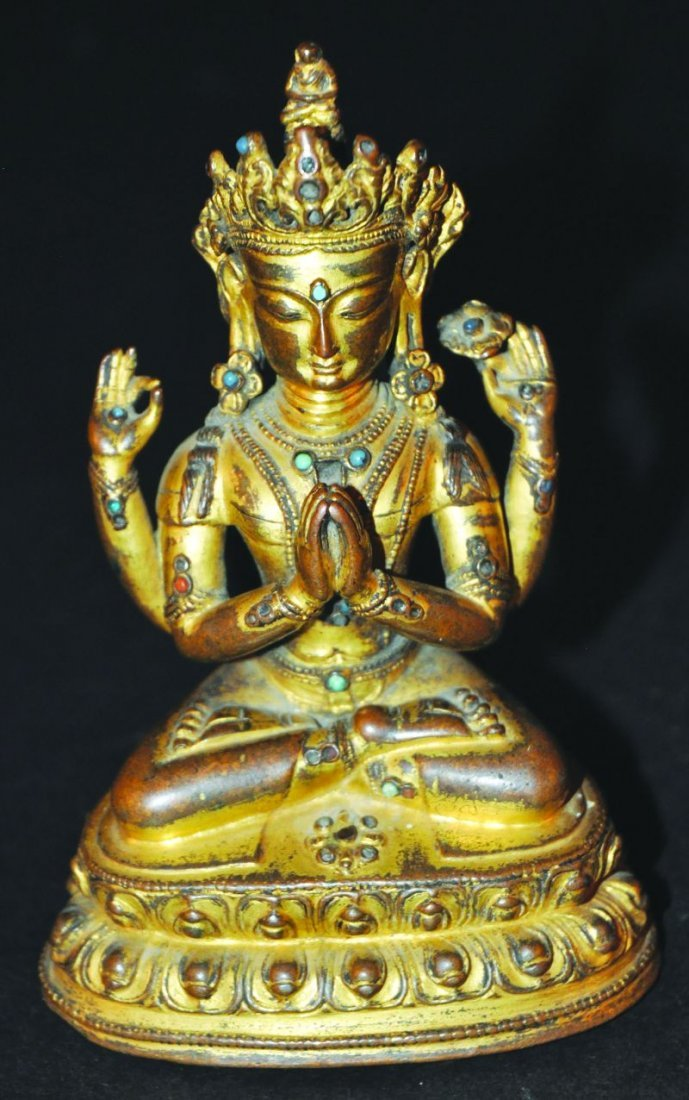 A FINE 14TH/15TH CENTURY TIBETAN GILT BRONZE FIGURE OF