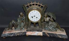 AN ART DECO FRENCH METAL AND MARBLE MANTLE CLOCK THREE