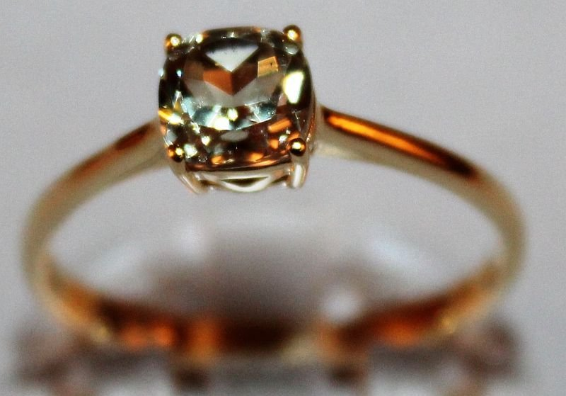 A SINGLE STONE CSARITE RING, 1.14cts set in 10k gold.