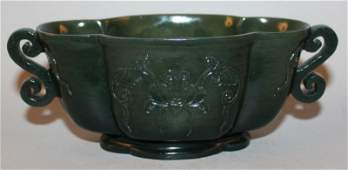 A CHINESE SPINACH-GREEN JADE-LIKE BOWL, of