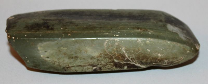 A CHINESE NEOLITHIC JADE AXE, the angular stone of