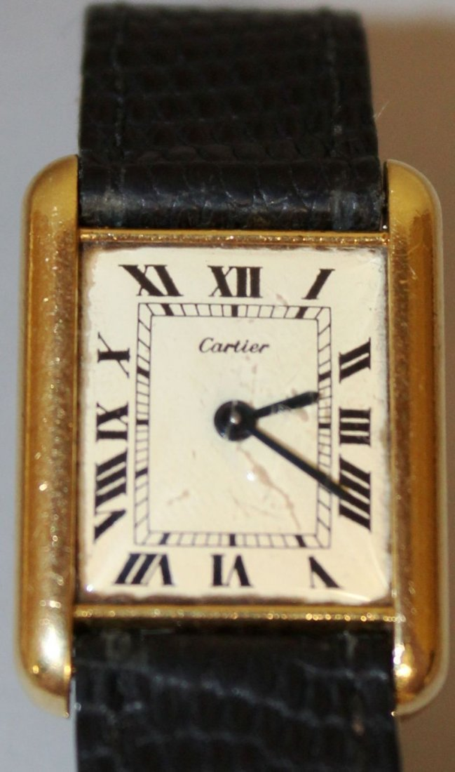 A CARTIER TANK WATCH with leather strap, in original
