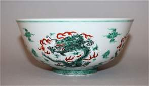 A CHINESE FAMILLE VERTE DRAGON BOWL painted with