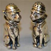 A PAIR OF CONTINENTAL SILVER NOVELTY DOG SALT AND