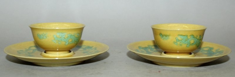 A PAIR OF CHINESE GREEN ENAMELLED YELLOW GROUND