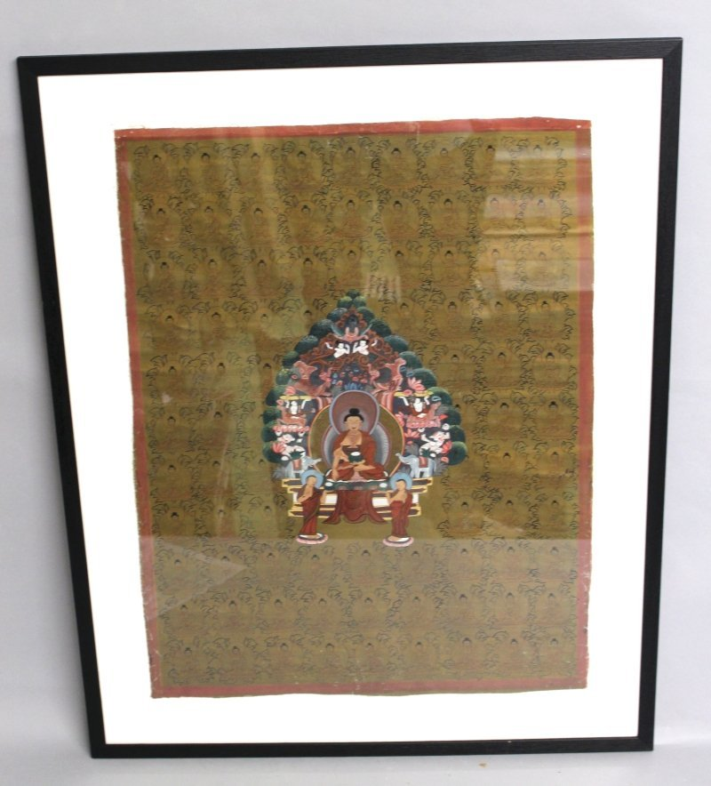 A 20TH CENTURY FRAMED TIBETAN THANGKA, painted with