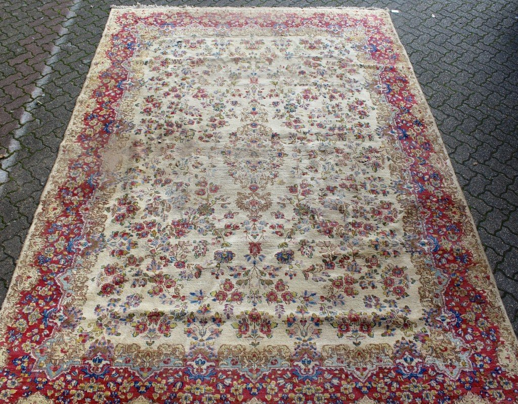 A KERMAN CARPET, cream ground with floral decoration