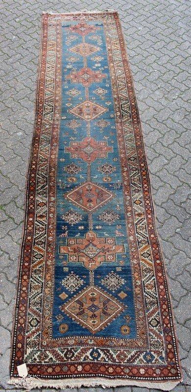 A PERSIAN RUNNER, Caucasian design, central blue ground
