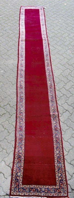 A PERSIAN KASHAN, claret ground field through the
