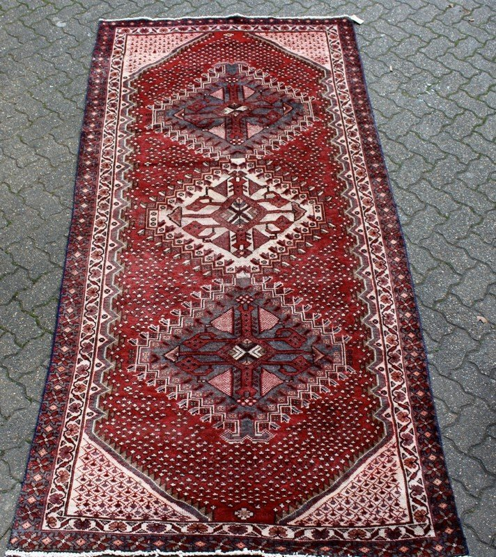 A SHIRAZ CARPET, red ground with three large central