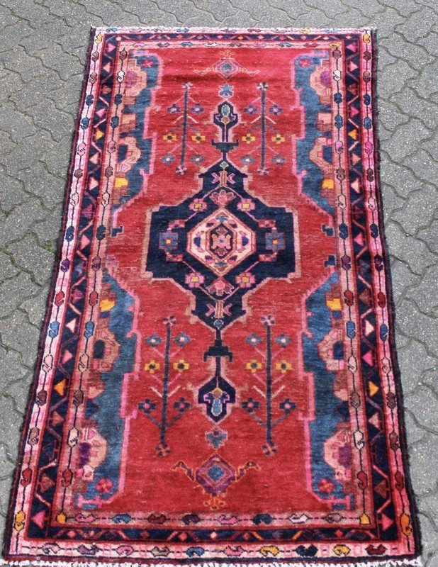 A SMALL HAMADAN RUG, bright red ground with stylized
