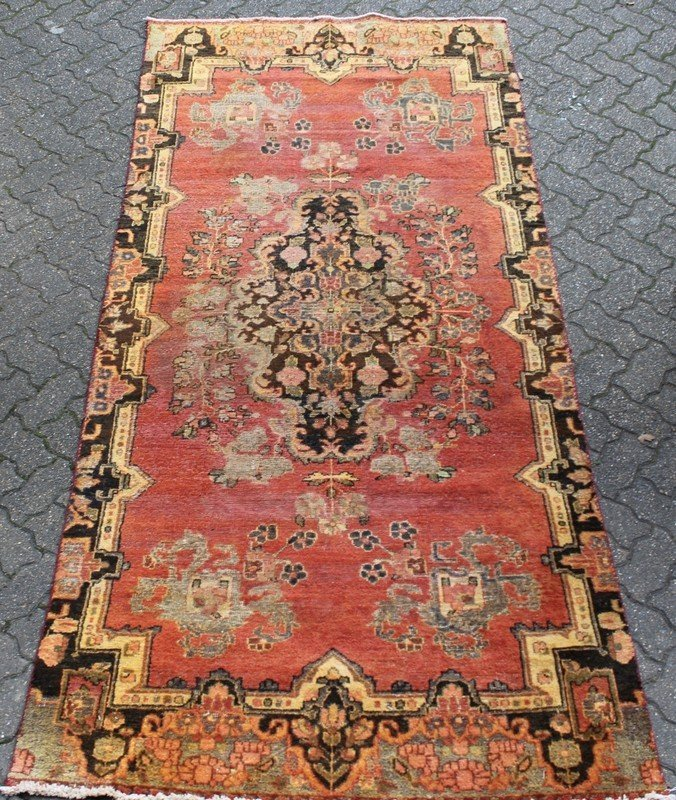 A HAMADAN RUG, rust ground with stylized floral