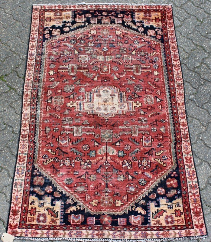A HAMADAN RUG, rust ground with stylized motifs within