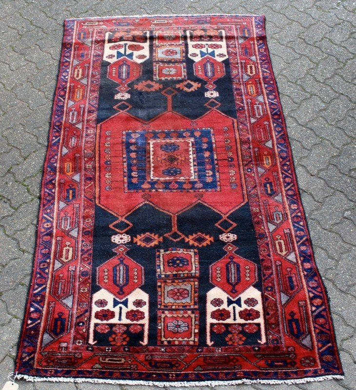 A MODERN HAMADAN RUG, black ground with central red