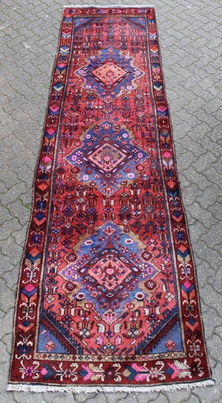 A HAMADAN RUNNER, blue ground with stylized floral