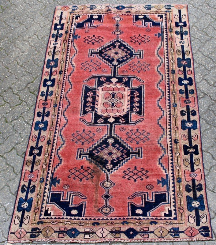 A SMALL HAMADAN RUG, pink ground with three central