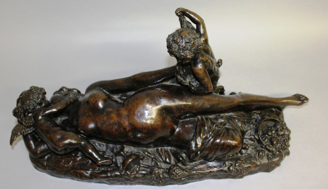 A SUPERB CLASSICAL BRONZE GROUP OF A RECLINING NUDE