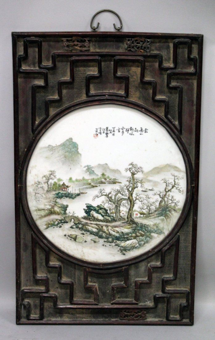A LARGE CHINESE WOOD FRAMED CIRCULAR PORCELAIN PLAQUE,