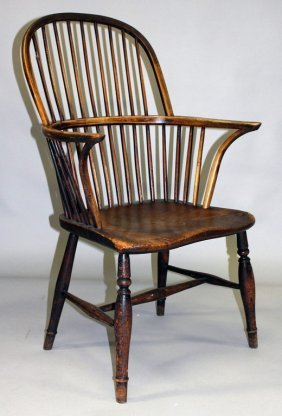An Oak And Elm Spindle Back Armchair.