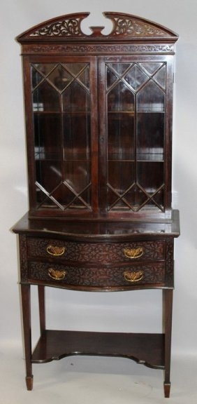 A Late Edwardian Mahogany Cabinet With Pierced Arched