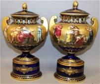 A SUPERB PAIR OF VIENNA TWO HANDLED URNS AND COVERS ON