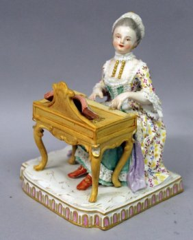 A 19th Century Meissen Figure Of A Woman Playing A