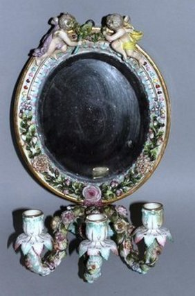 A Dresden Augustus Rex Oval Mirror Surmounted By Two