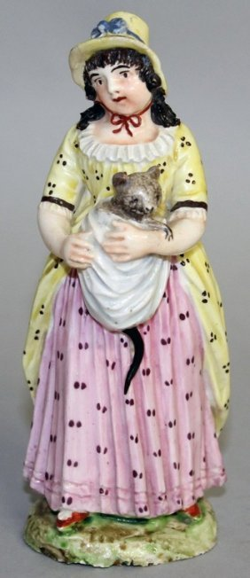 A Rare Naples Figure Of A Young Girl Holding A Baby