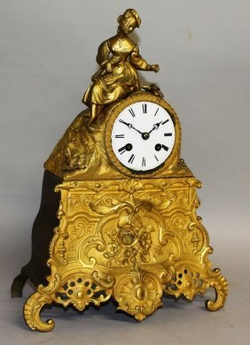 A 19th Century French Gilt Mantle Clock, Surmounted By