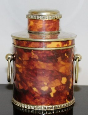 A Circular Tortoiseshell And Plate Tea Caddy And Cover.